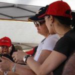Female instructor showing female shooter proper grip
